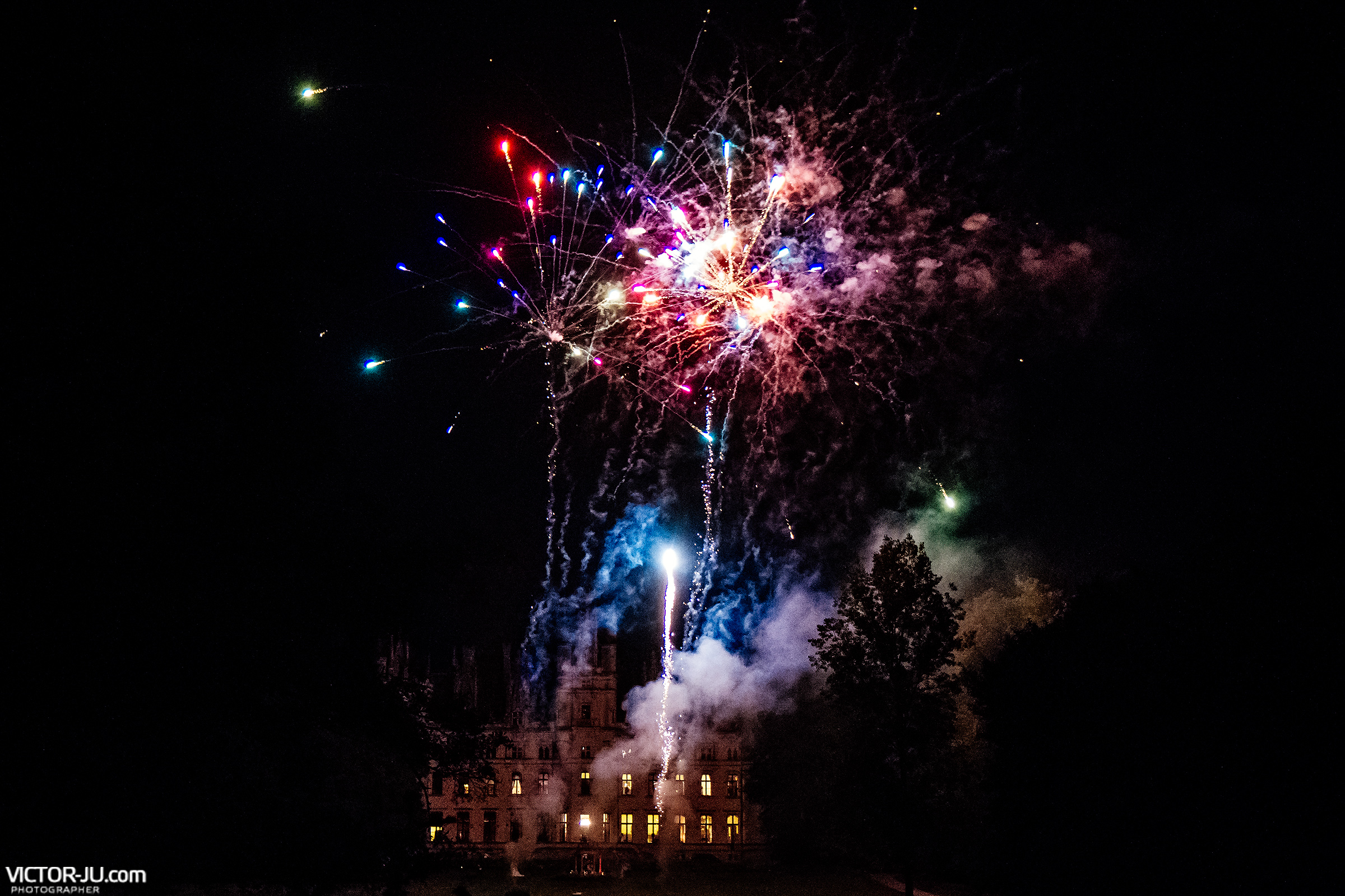 Celebratory wedding fireworks in the castle of Château de Challain